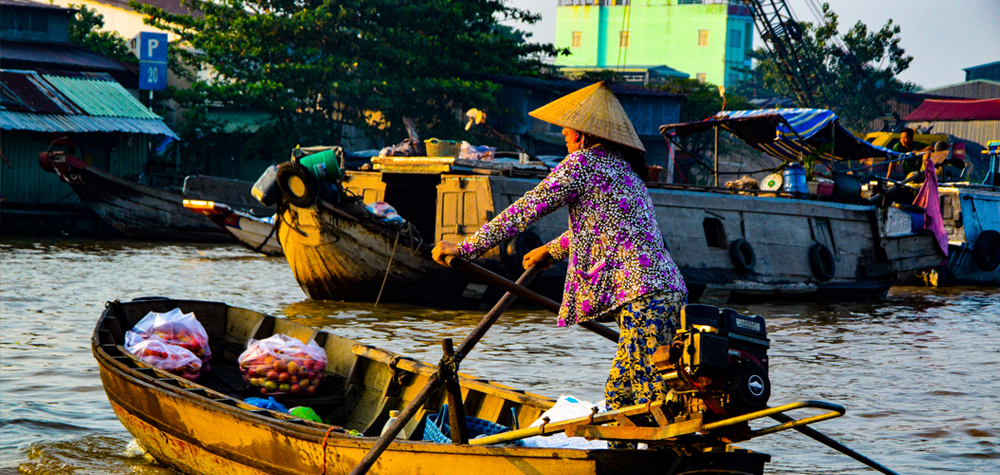 woman in a fishing boat, colorful surroundings