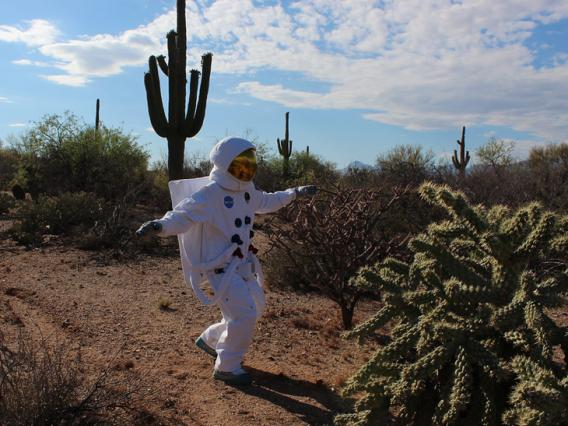 UArizona astronaut leaping in the desert