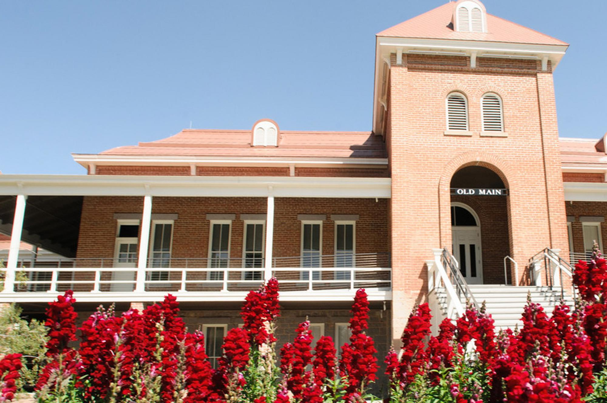 view of Old Main with blooming flowers, University of Arizona